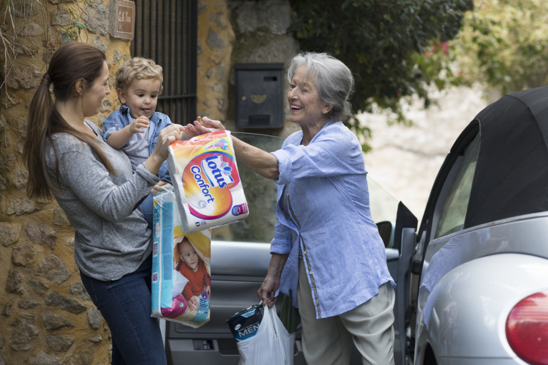 Grandmother_mother_baby_unloading_diapers_from_car_2.tif